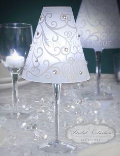 Turn ordinary Wine or Champagne Glasses into elegant centerpiece.  Wine/Champagne glass, Vellum scrapbook paper, rhinestones & battery tea light.