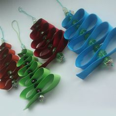 These Christmas decorations have been made with glass crystal beads & grosgrain ribbon
