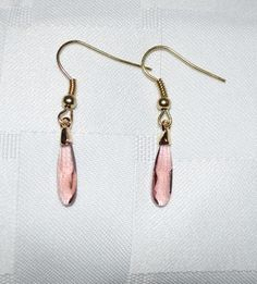 Stunning Swarovski Rose Blush Raindrop Crystal (17.5 X 4mm) mounted in a gold setting. Gold ear wire (plated).