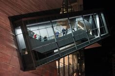 The 54-foot escalator at the Perot Museum of Nature and Science is contained in a glass-and-steel structure visible on the outside of the building. (Mei-Chun Jau/Special Contributor to The Dallas Morning News)
