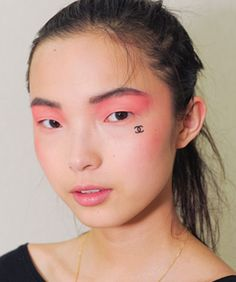 Chanel face tattoos...would you don this beauty mark?