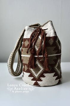 This is a beautiful hand woven cotton Mochila Bag. It is inspired by Wayuu tribal craft that origins in Colombia. Each bag is handcrafted carefully with love to deliver 100% satisfaction. The pattern is designed by Auntie Lonya and no two products are alike. This boho style bag