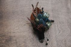 Moody fall boutonniere | Image by Lindsay Nickel