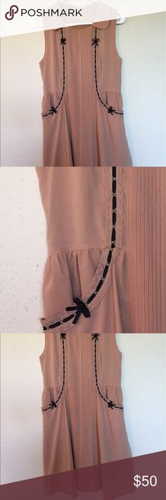 Feminine semi-formal collared dress Light pinkish dress with navy blue detail ribbon. Only worn once and does not fit me anymore, but is in really good condition. Dresses Mini