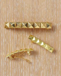 Barrettes  These studded barrettes are a chic accent to any ensemble.     Tools and Materials Barrettes Superglue Pyramid studs Round needle-nose pliers