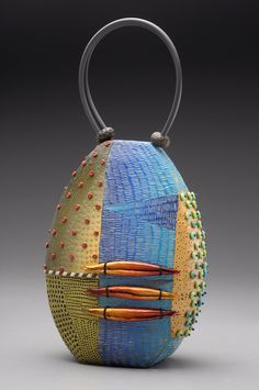 Trabzon Purse made of colored polymer clay with intricately hand-applied texture in layers of pattern. Kathleen Dustin