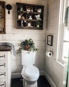 This farmhouse bathroom design embraces contrast & warm wood hues with a butcher block countertop, white shiplap walls, and greenery. Love this wood cubby over the toilet! Bad Inspiration, Bathroom Inspiration, Bathroom Ideas, Bathroom Organization, Bathroom Remodeling, Bathroom Storage, Organization Ideas, Bathroom Vanities, Remodeling Ideas
