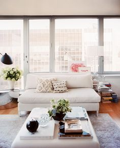 Michelle Adams Photo - A square coffee table and a white settee in a light-filled living space