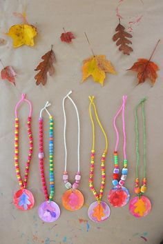 Painted leaves make for great pendants on a nacklace! With just a little string and some beads, your kids will be all decked out at dinner.  Photo:  Art Bar