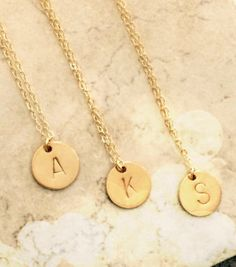 A personal favorite from my Etsy shop https://www.etsy.com/listing/239711270/gold-initial-necklace-pendant-necklace