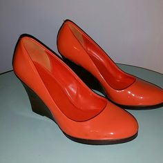 Cole Haan Orange wedges 7.5 Beautiful! Gently loved. Small scuff mark shown in pic. Genuine leather Cole Haan Shoes Wedges