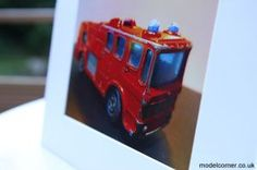 "Dad's Old Cars Fire Truck Picture - Miro says ""I like the shape of the old cars. I like the fact their paint is chipped and not brand new as I can see that my dad played with them when he was a boy. I have urged myself to set up a business. I like being a business-boy and I hope you enjoy my Dad's Old Cars photographs."