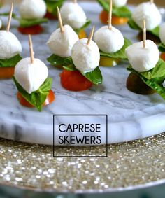 Caprese Skewers: tomato, basil leaf, mozzarella cheese. Drizzle with balsamic vinegar or oil.