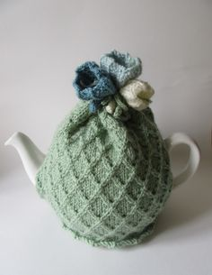 Hand knitted green tea cosie with crocus flowers £18.00