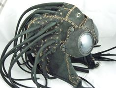 The Oakley Medusa (2008) features a Subversive design with soft high-density foam lining,  adjustable chin strap, leather dreadlocks with strap tie down, and rivets for attachment of leather goggle
