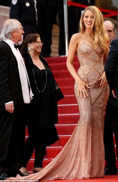 Golden girl: The Gossip Girl actress simply stunned in a glittery gold gown with sheer panels as she attended the premiere for Cafe Society in Cannes on May 11