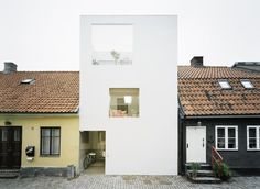 Architect: Elding Oscarson Location: Landskrona, Sweden Structural Engineer: Konkret Builder: Skånebygg Gross Floor Area: 125 sqm Construction Cost: 280,000 Euro Project Year: 2009 Photographs: Åke E:son Lindman The narrow site is sandwiched between very old neighboring buildings in Landskrona, Sweden. Since mid 20th century it has been empty, waiting behind a wooden fence. It is only 5 meters..