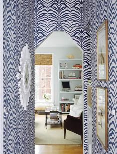 Zebraprint wallpaper in the hall? Why not? It's a transitory space, and it would bring great delight as one walks through it.