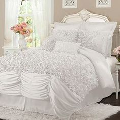 "Add feminine-chic flair to your master suite or guest bedroom with this faux silk comforter set, showcasing layers of ruched detailing and hand-sewn bows.          Product: Queen: 1 Comforter, 1 bed skirt and 2 standard shamsKing: 1 Comforter, 1 bed skirt and 2 king shamsCalifornia King: 1 Comforter, 1 bed skirt and 2 king shams   Construction Material: Faux silk    Color: White Features:  Hand-sewn bows14.5"" Bed skirt drop   Dimensions: Standard Sham: 20"" x 26"" Queen Comforter: 92"" x ..."