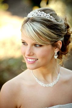 Wedding Hairstyles Updo with tiara and veil attached in the back of the up do.