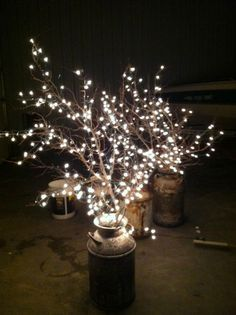 DIY Why Spend More: Milk cans + branches + white lights for wedding reception lighting