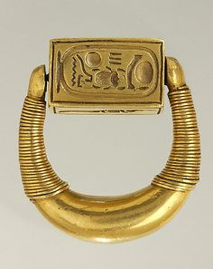 Coronation name of Horemheb, signet ring of Horemheb, the last pharaoh of the 18th Dynasty of Egypt. This solid gold signet ring is exceptional for its size and the quality of its workmanship. Spirals are added toward the rounded ends of the very thick ring, and the four faces of the rectangular, rotating bezel are deeply engraved with a crocodile, a scorpion, a lion, and the coronation name of Horemheb, the last king of the 18th Dynasty. Louvre Museum, Paris