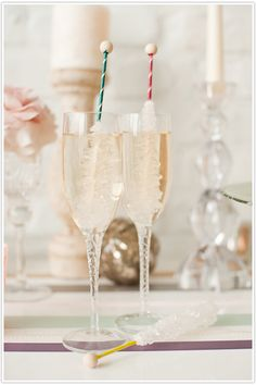 Rock candy stir sticks in champagne.  Kid-in-me Meet Grown-up-self!