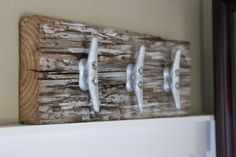 Nautical coat rack with boat cleats, made from reclaimed wood.  Scott save the old boards from pier.