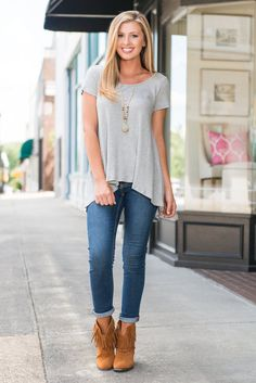 All you need is this top and it's that easy to look trendy! You can't go wrong with a solid gray top! Especially one this soft! You are going to love it's loose cut and it's textured fabric! Because of it's length you will probably want to pair it with skinnies or crop jeans.