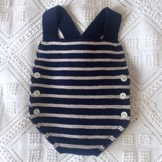 Handmade romper, size 6-9 months, sailor style: navy blue and grayish blue, quality 100% acrylic type mercerized cotton, very soft to the touch and the babys skin.  Stockinette stitch, 1x1 rib and garter stitch.  My products are knitted by me, with love and delicacy in a non-smoke environment and away of pets.  This product is available to be sent, should you want a custom order, choosing another color or type of button do not hesitate to contact me.
