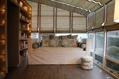 Moving Summer Inside: Daybeds in Sunrooms