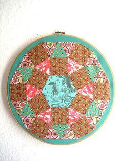 Paper pieced hoop art by berlinquilter, via Flickr