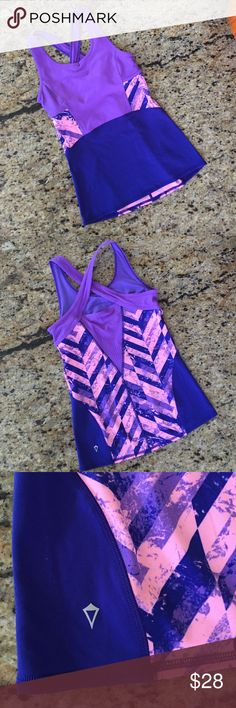 Ivivva New Without Tags Tank Ivivva tank, new without tags, size 14. Gorgeous pink and purple top. Matching Set the Pace Skirt listed separately. Ivivva is Lululemon's brand for girls. Ivivva Shirts & Tops