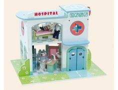 The Le Toy Van Hospital Set is a painted wooden hospital in the Budkins range.    This hospital with a working lift includes lots of fun accessories as shown, including a bed for poorly budkins and a chair and computer desk for the doctors and nurses. Don't forget to wash your hands in the sink! The hospital also features opening doors. No assembly required. Budkins dolls sold separately.