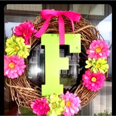 This inspired the wreath on our front door-  our letter is wrapped in green moss, and we have an orange and cream flower rather than the brightly colored ones.