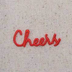"Cheers WORD High quality, detailed embroidery applique. Can be sewn or ironed on. Great for hats, bags, clothing, and more! Size is approx. 1-1/2"" x 1/2"" or 3.81cm x 1.27cm"