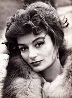 Anouk Aimee, 1960,//  (born 27 April 1932) is a French film actress. Aimée has appeared in 70 films since 1947. She began her film career in 1947 at age 14. In 1958, she portrayed the tragic artist Jeanne Hébuterne in the film Les Amants de Montparnasse. She appeared in La Dolce Vita, 8½ and Jacques Demy's Lola.  She won the 1967 Golden Globe Award for Best Actress - Motion Picture Drama