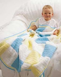 Cute and simple afghan is perfect for little boys and girls with alternating color and star squares. Approx 32 x 40 ins [81 x 102 cm]. Crochet in Bernat Baby Coordinates White, Yellow, and Aqua on size 4 mm (U.S. G or 6) crochet hook.