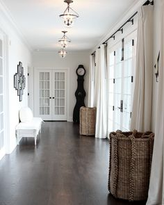 A closer view – showing the back French doors leading to the master bedroom, closed.  I love the oversized baskets – they are found throughout the house.