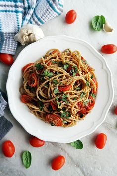 A quick and easy vegetarian pasta dish; Black Pepper and Parmesan Spaghetti with Garlic Roasted Tomatoes.