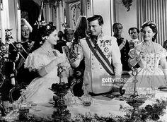 Austrianborn French actress Romy Schneider touching glasses with Austrian actor Karlheinz Boehm in the film Sissi Austria 1955