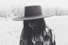 Woman's black felt wide-brimmed hat; Spanish hat.