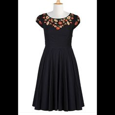 "New Eshakti Black Fit & Flare Dress 10 New Eshakti black fit & flare dress with floral embroidered neckline. Size 10 Measured flat: underarm to underarm: 35"" Waist: 30"" Length: 40 ½""  Eshakti size guide 10 bust: 37"" Princess seamed bodice, banded waist, side hidden zipper. Flared skirt, side seam pockets. Set in cap sleeves. Cotton, woven poplin, no stretch, pre-shrunk & bio-polished. Machine wash eshakti Dresses"