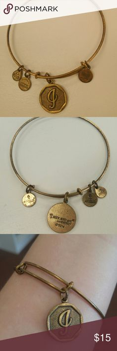 """Alex & Ani gold bangle Authentic Alex & Ani adjustable gold bangle with """"J"""" initial! Gently worn, slight tarnishing shown in pictures. Great for layering with other bangles!  - I do bundle discounts - Ask any questions! - Reasonable offers will be considered!  Jewelry initials personalized golden bangle bracelet accessory Alex and ani Alex & Ani Jewelry Bracelets"""