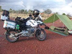 BMW R1150 GSA. Bush camp west of Eulo western Queensland Aust. Old road work sites are often as good as you might get for a bush camp. If possible, I camp on the opposite side of any earthern berms (out of sight is out of mind) and these sites are usually relatively level. In remote areas, there are usually no fences to hinder off road access, but I never light a camp fire. As romantic as it might seem in a movie, camp fires attract unwanted attention, risk setting fire to any grass/bush…