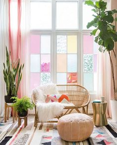 living room w/ lovely pastel colored glass windows, lots of plants, patterned rug #home decor / styling
