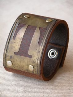 Brown crackle leather cuff with vintage by BlackHeartIndustries, $35.00