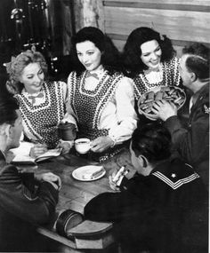 Ann Sothern, Hedy Lamarr & Linda Darnell serving men in uniform at the Hollywood Canteen