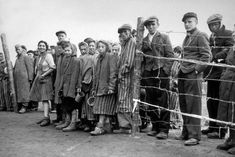 Bergen Belsen prisoners are queuing for food right after the liberation of the concentration camp by the British. Within the few weeks after this photo was taken at least 10,000 prisoners died because of malnutrition and disease.