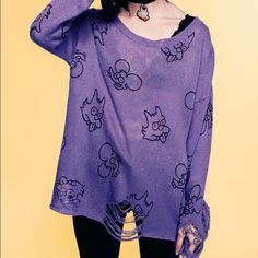"""Drop dead itchy scratchy let them eat sweater Drop dead itchy scratchy """"let them eat"""" distressed oversized sweater jumper. Practically Nwot washed and laid flat to dry.  Never worn out, only tried on. Purple with itchy and scratchy all over. 80% acrylic 20%nylon. Size S/M Drop dead Sweaters"""